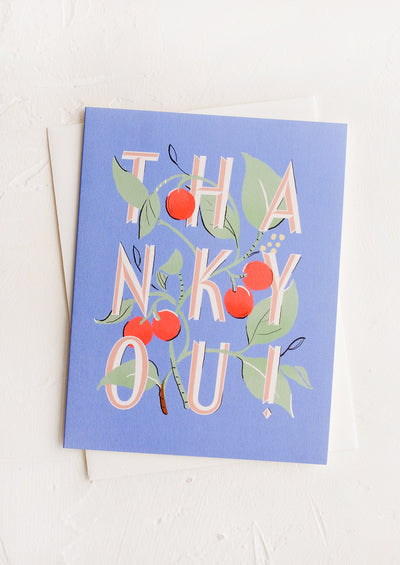 "A blue greeting card with ""THANK YOU!"" intertwined with cherries."