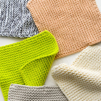 1: Chunky knit potholder squares in assorted colors.