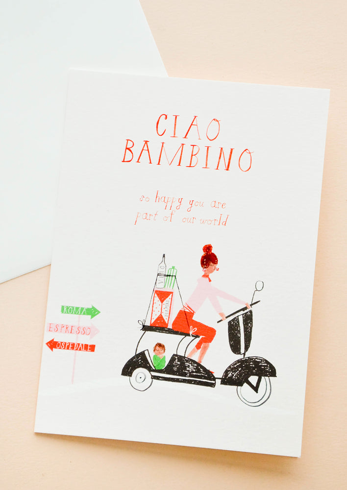 1: Greeting card with woman in Italy on a vespa carting baby supplies in the back