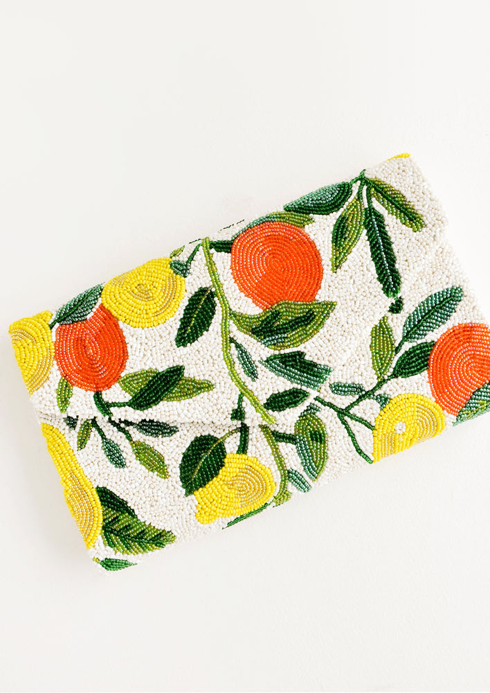 Envelope style clutch with flap front, allover beaded citrus print