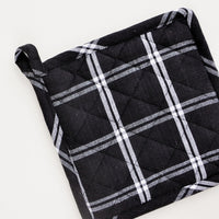 Black Check: A black and white grid check potholder with loop at one corner.