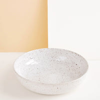 Pasta Bowl [$58.00]: Shallow ceramic bowl, ideal for pasta, in white glaze with brown speckles.