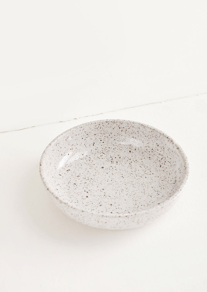 Salad Bowl [$48.00]: Shallow ceramic bowl, ideal for salad, in white glaze with brown speckles.