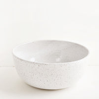 Serving Bowl [$98.00]: Hearty ceramic bowl, ideal for serving or mixing, in white glaze with brown speckles.