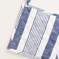 Indigo Stripe: A blue and white striped potholder with loop at one corner.