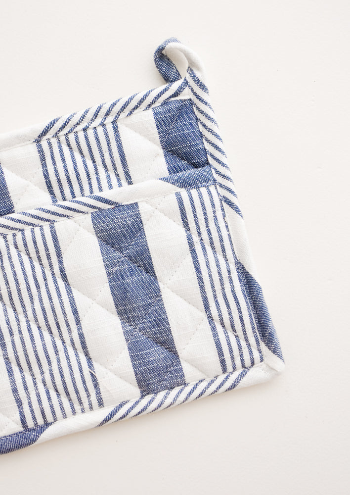 3: A blue and white striped potholder with loop at one corner.