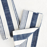 1: White and blue striped cotton napkins, pictured folded as a pair.