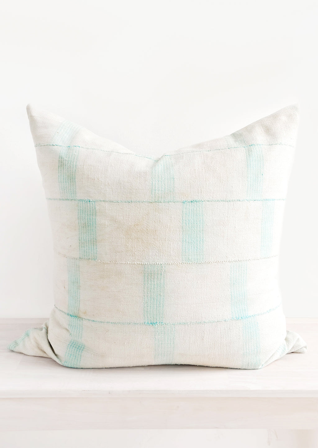 1: Square throw pillow in faded vintage fabric with vertical line print