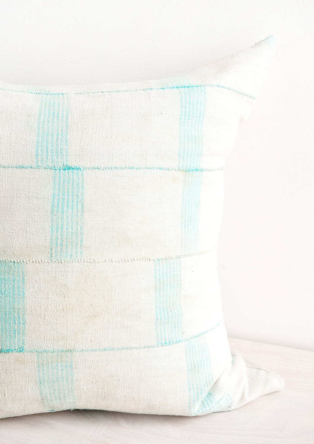 2: Square throw pillow in faded vintage fabric with vertical line print