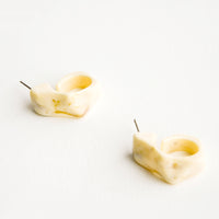 3: Faceted, hoop-like post back earrings in marbled ivory acetate