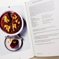 3: Inside of a cookbook, featuring recipe and image of a drink.