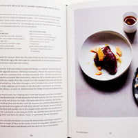2: Inside of a cookbook, featuring recipe and image of a drink.