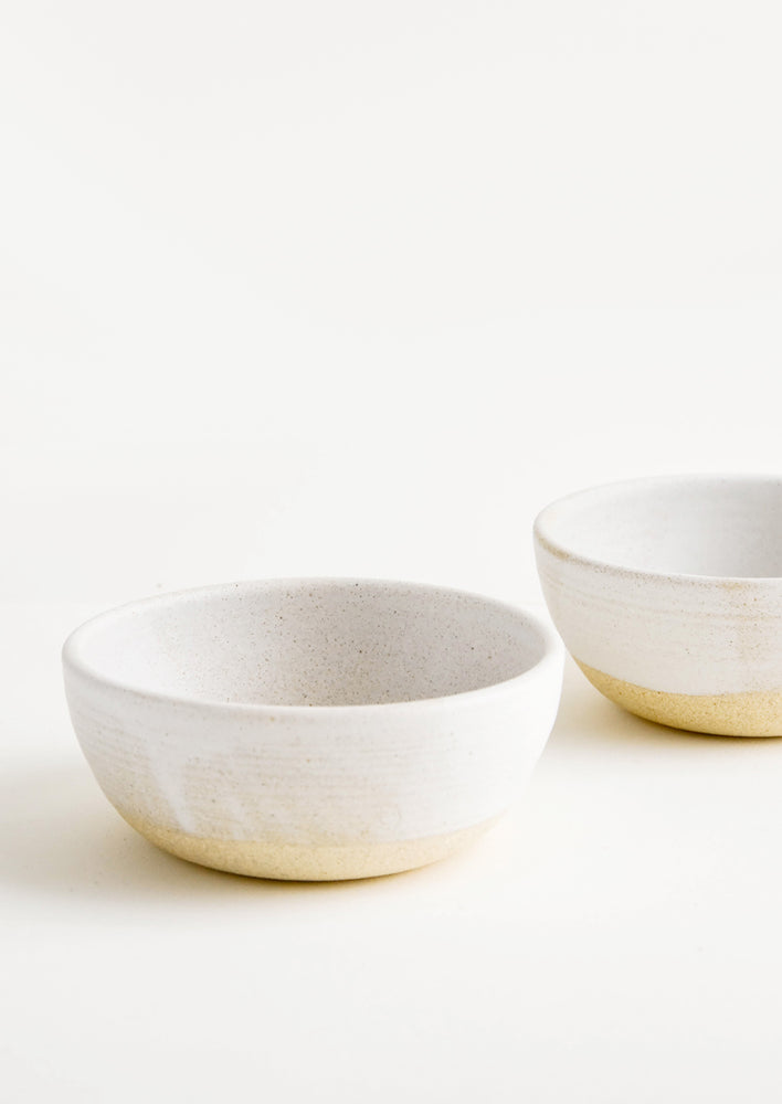 Warm White / Soup: Two white ceramic bowls.