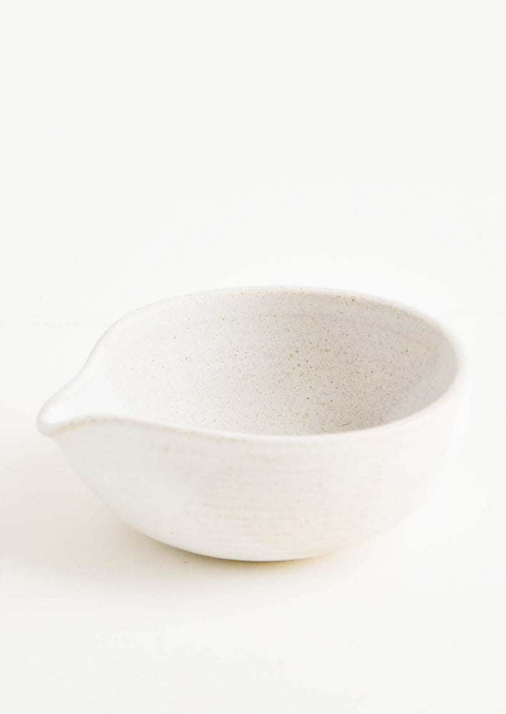Warm White: An ivory spouted ceramic bowl.