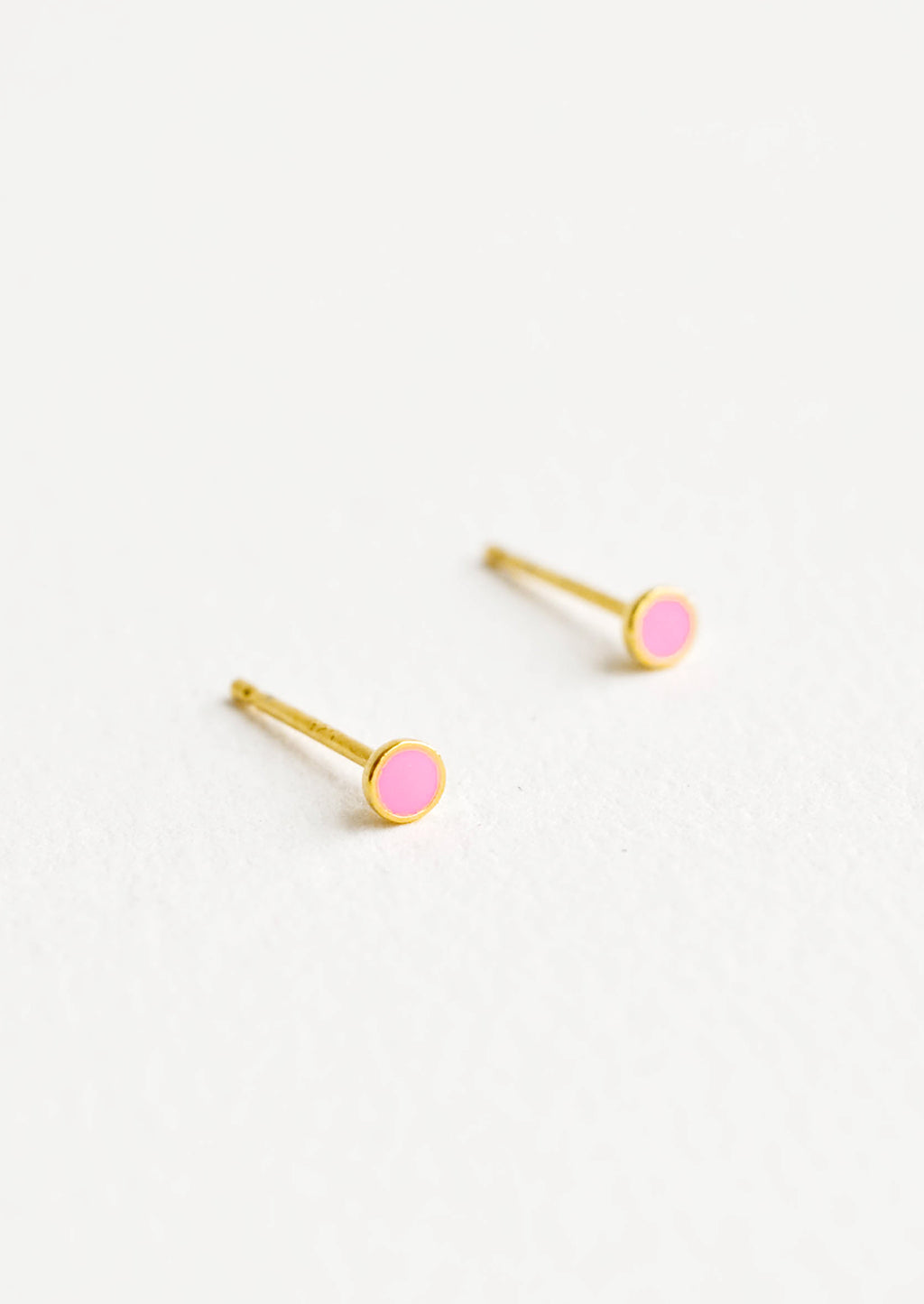 2: Round studs with neon pink enamel circle and gold bezel.