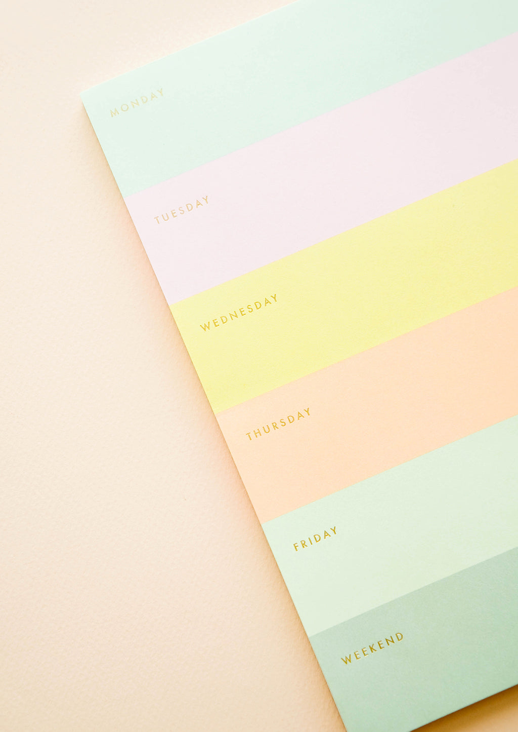 2: Close up of color blocked weekly planner.