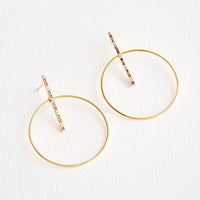 1: Round gold circle earrings with post across center of circle, featuring colored crystals