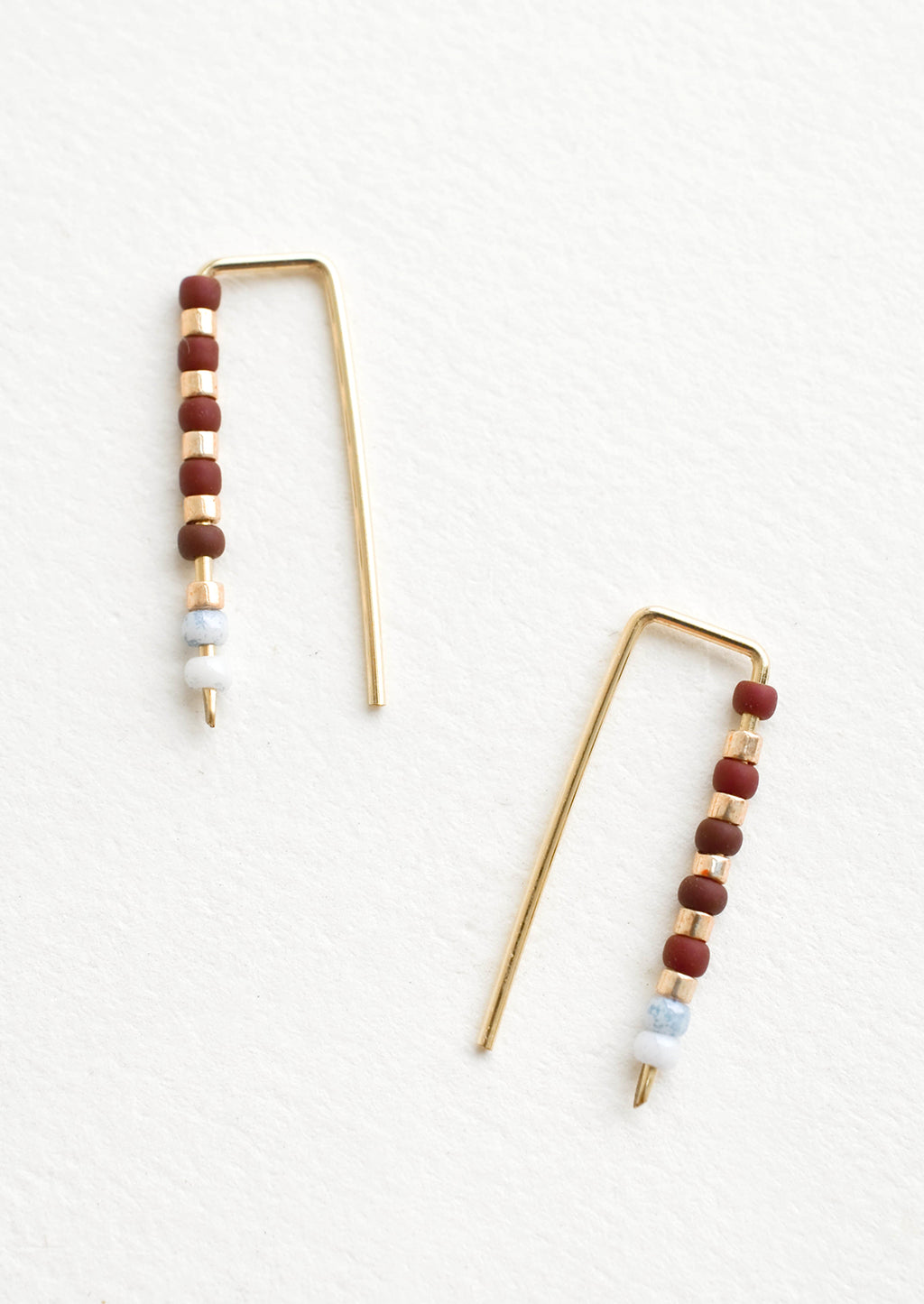 Merlot / Grey: Staple shaped earrings in gold metal with stacked glass seed beads on one side in a mix of colors