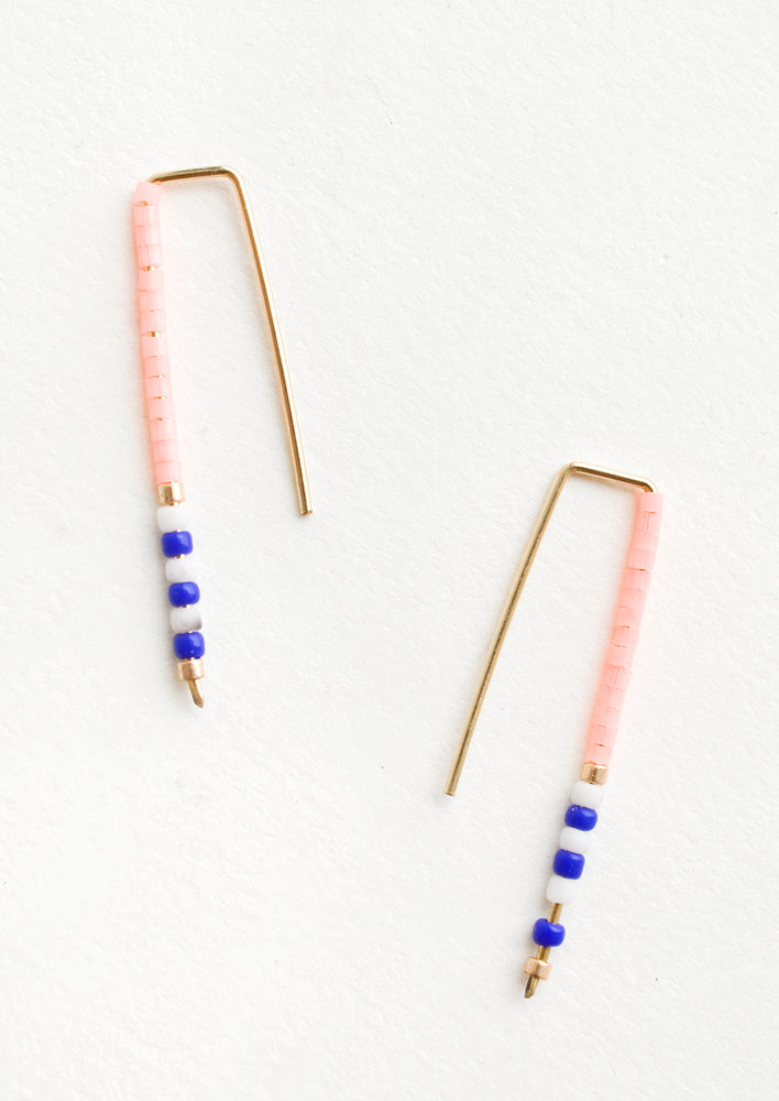 Neon Peach / Cobalt: Staple shaped earrings in gold metal with stacked glass seed beads on one side in a mix of colors
