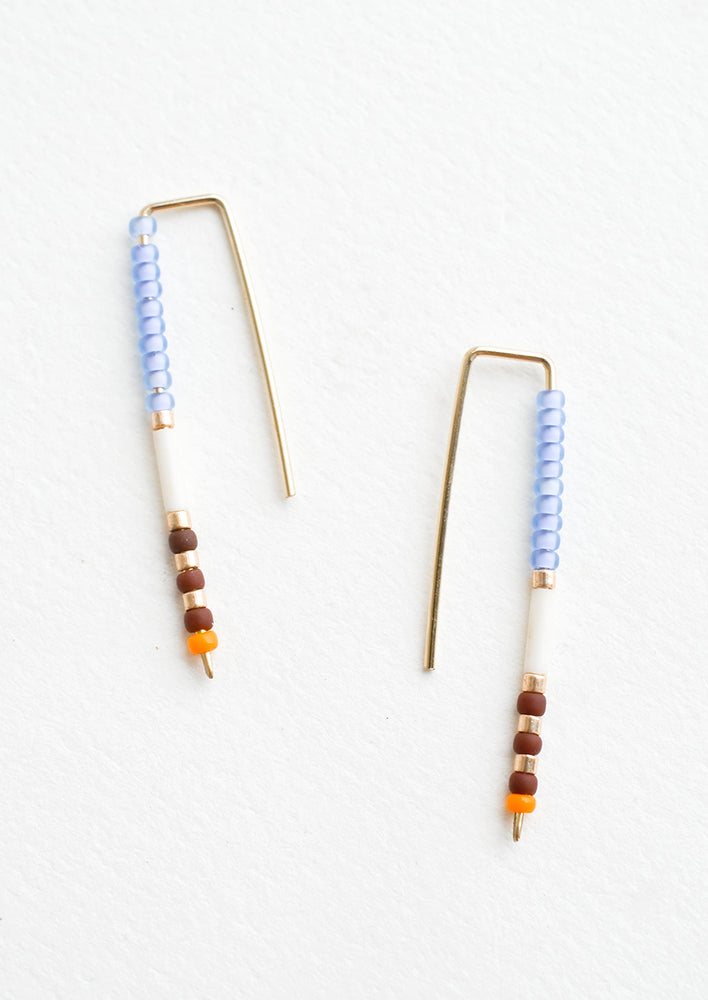 Periwinkle / Merlot: Staple shaped earrings in gold metal with stacked glass seed beads on one side in a mix of colors