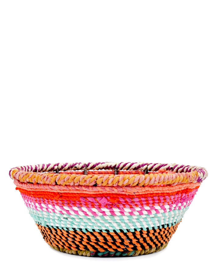 3: A woven fabric bowl in multicolored stripes.