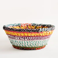 1: A woven fabric bowl in multicolored stripes.