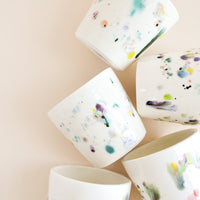 1: Small, one of a kind ceramic tumblers in ivory with colorful drips