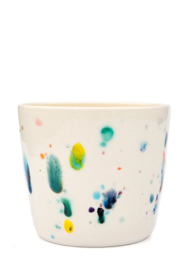 2: Short ceramic cup with colorful glaze drips