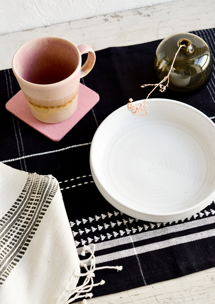 3: A table setting with black placemat.