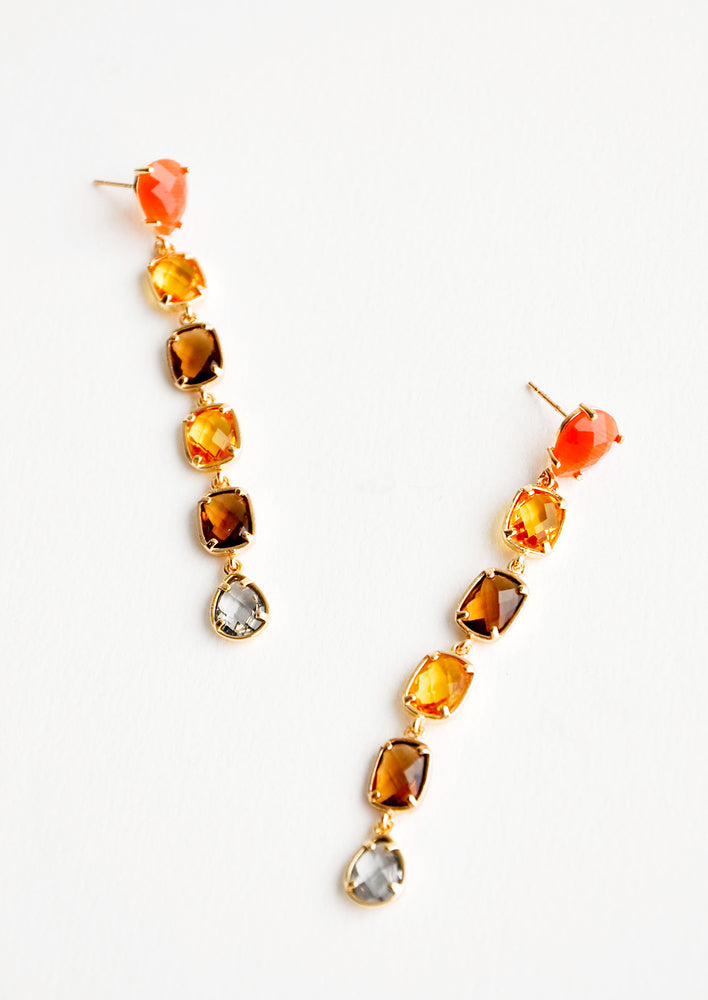 1: Post back drop earrings with six glass crystals of orange, yellow, amber, and blue.