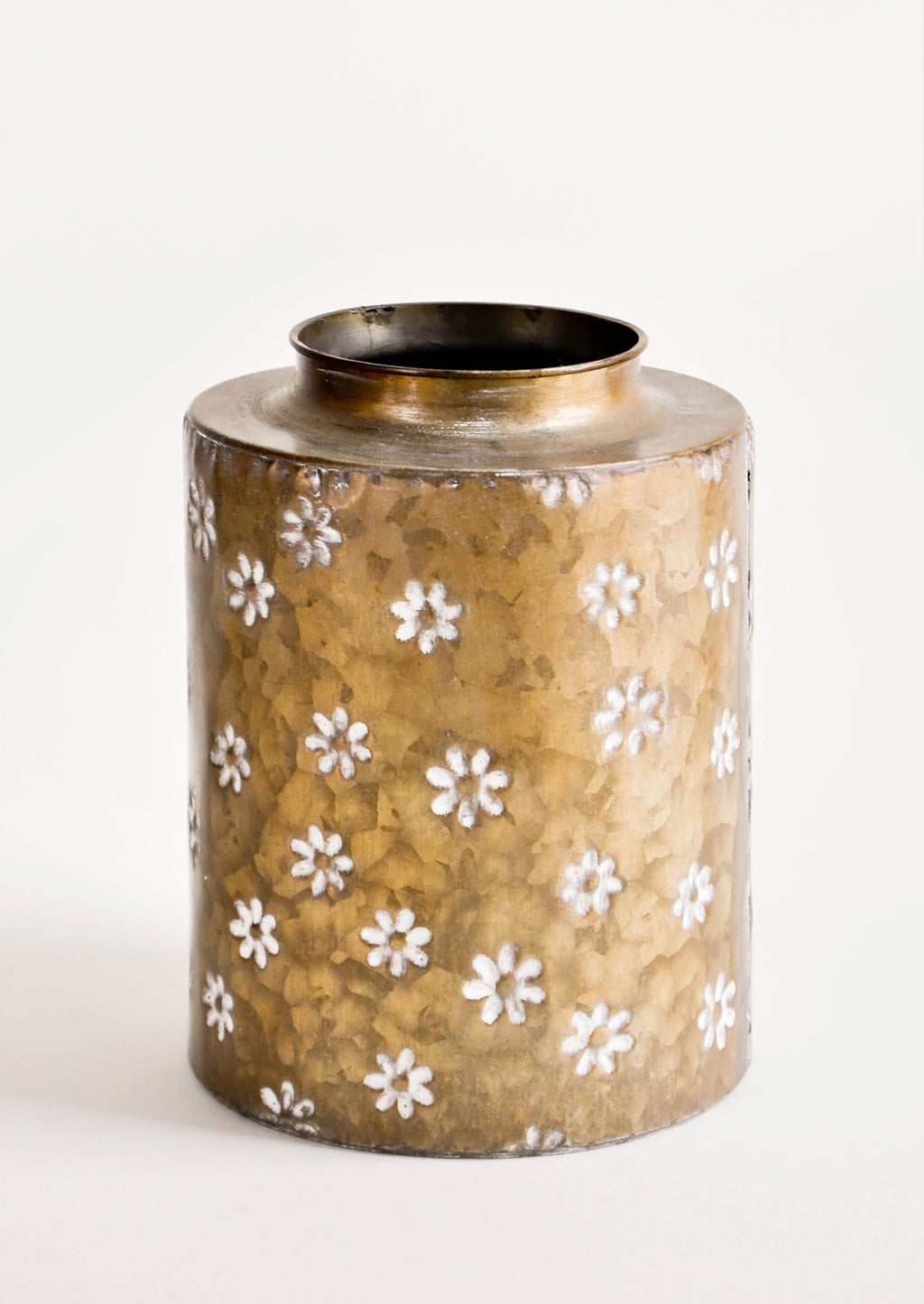 Brass [$42.00]: Wide and round brass metal vase with hammered texture and allover white floral print