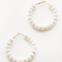 Pearl: Hoop earrings made of small white beaded balls arranged in a circle.
