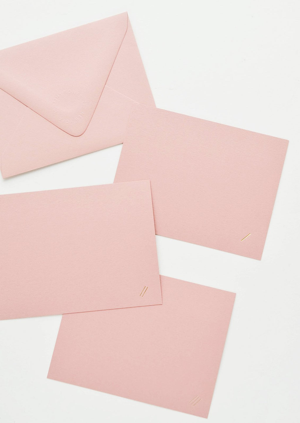 Set of 6: A pink envelope and three pink greeting card with two small gold foil diagonal lines at bottom right.