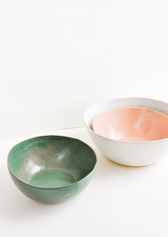 1: Three large ceramic bowls in green, pink, and white.