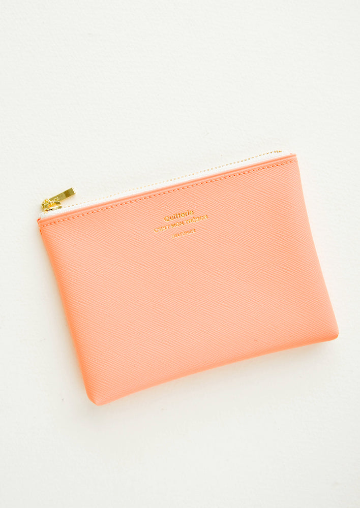 Peach / Small: Small vinyl coin pouch with gold zipper and crosshatch texture, in peach.