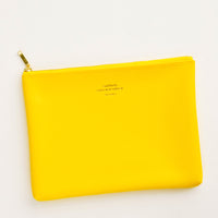 Yellow / Medium: Medium vinyl pouch with gold zipper and crosshatch texture, in bright yellow.