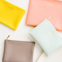 Yellow / Small: Product shot showing multiple styles and colors of pouches.