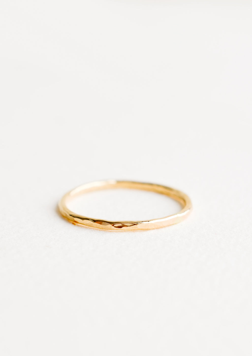 1: Thin hammered gold ring.