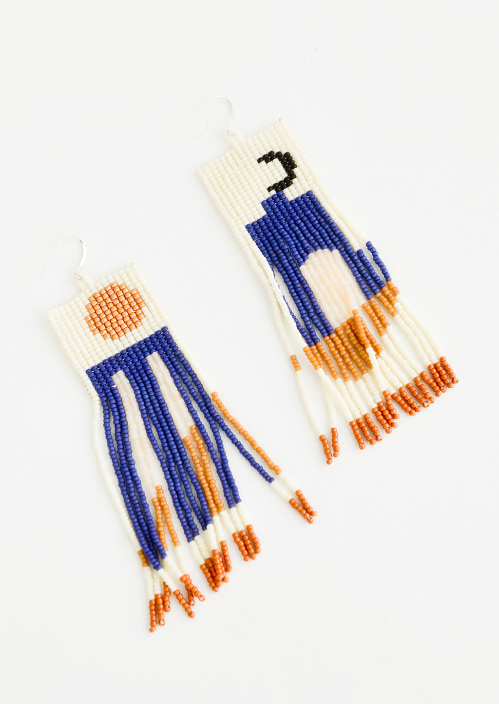2: Fringe earrings of cream, blue, orange, and black beads depicting abstract scenes of the sun and moon.