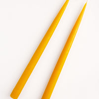 Honey: Pair of Two Taper Candles in honey yellow.