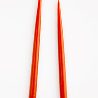 Rust: Pair of Taper Candles in deep red-orange.