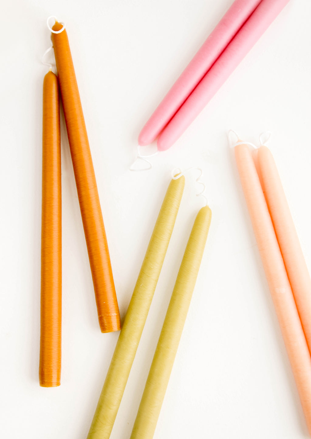 3: An arrangement of colorful taper candles