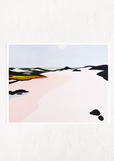 An art print with image of colorful sand dunes and water.