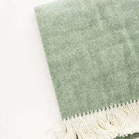Olive: Green throw blanket in fine herringbone weave and ivory tassel trim