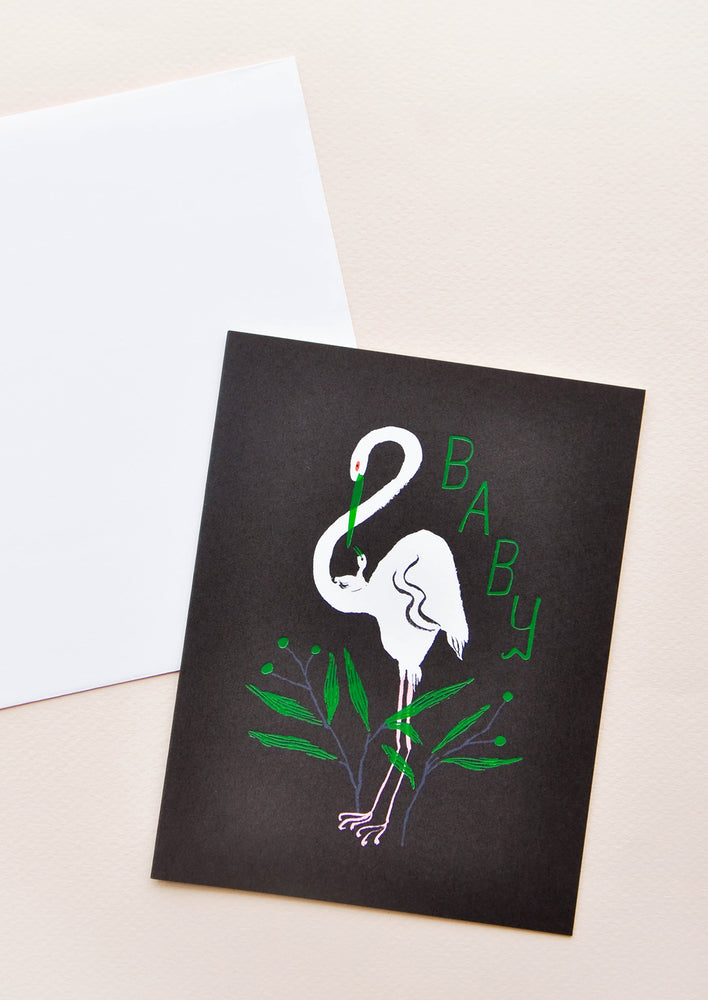 "1: Notecard with white egret on back background and green ""Baby"" text and decoration, with white envelope."