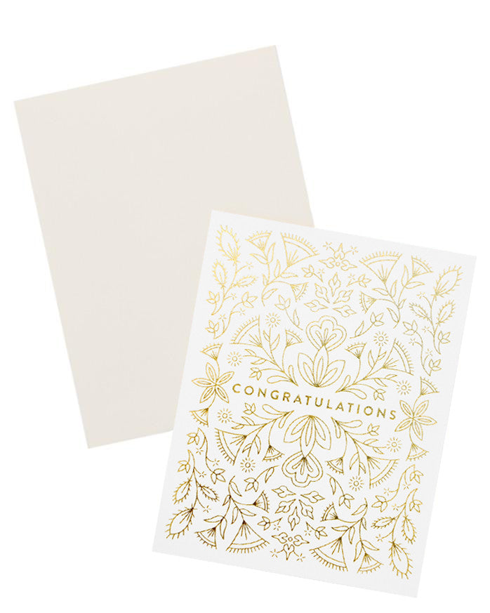 "2: Notecard with intricate gold metallic floral design all over and the text ""Congratulations"", with white envelope."