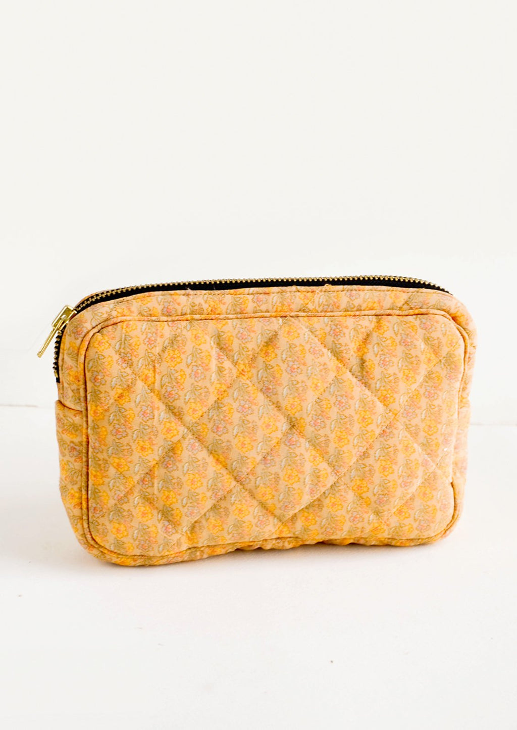 Small / Dainty Peach Floral: Flat and rectangular makeup travel bag with zip closure in yellow and peach floral