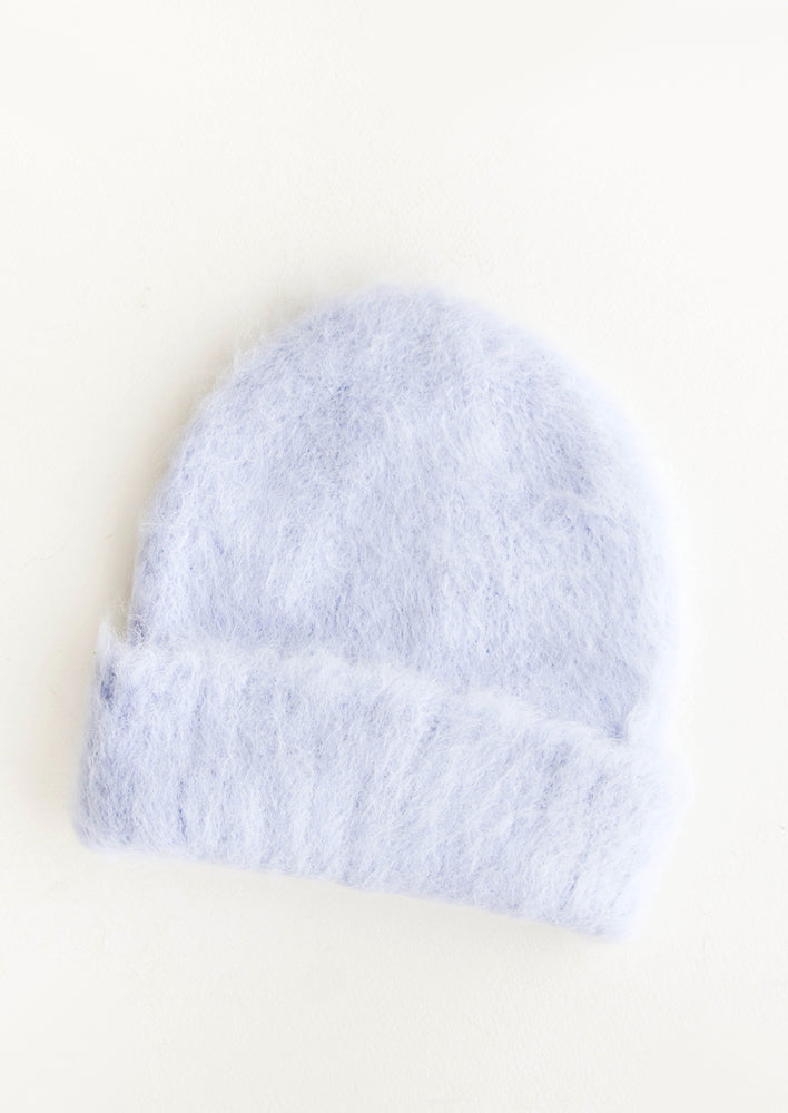 Cloud: Fuzzy pale blue beanie with bottom fold.