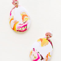 Sea Smoke: Pink, yellow, orange and white marbled clay earrings, with a larger oval dangling from a small circle.