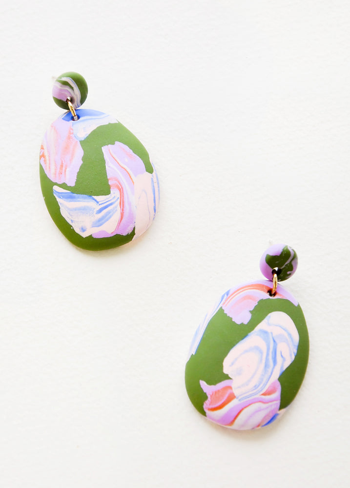 Rockpool: Pink, blue and green marbled clay earrings, with a larger oval dangling from a small circle.